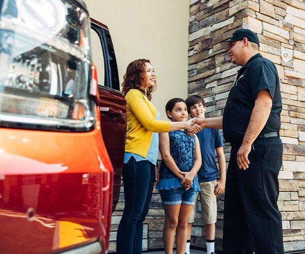 Jiffy Lube employee saying goodbye to family customers