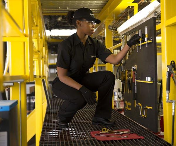 Jiffy Lube employee getting tools