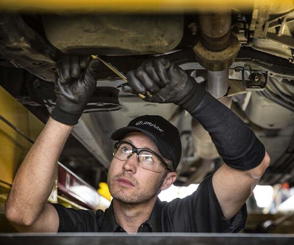 Jiffy Lube employee working underneath a vehicle