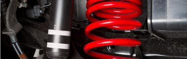 shock spring under a car tire